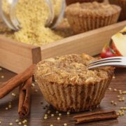Fresh muffins with millet groats, oatmeal flakes, cinnamon and apple baked with wholemeal flour, concept of delicious, healthy dessert or snack